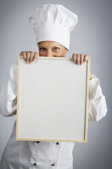 female  chef holding menu board