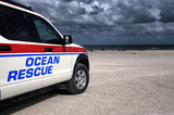 Ocean rescue vehicle on the lookout on the beach poster