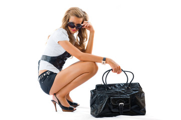Attractive girl with sexy dress and big fashion bag