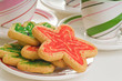 Plate of colorful christmas sugar cookie shapes.