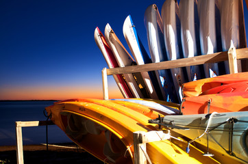 Colorful Kayaks lined up in Honeymoon Island, Florida.