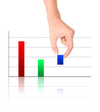 Colorful increasing bar graph - Hand holding smallest pole