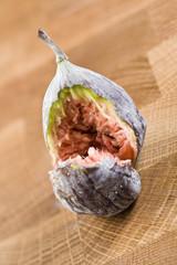Fresh fig bitten in half