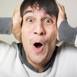 Man coverings his ears