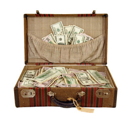 Vintage suitcase full of cash in US currency.