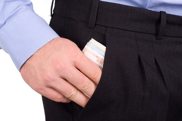 Businessman Putting Money Into Pocket