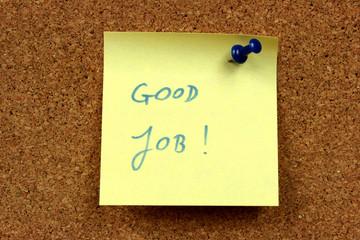 Sticky note, bulletin board. Good job - motivating message.