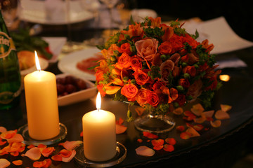 Close up of table decorated with burning candles and flower