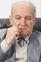 Portrait of a senior man taking his medication.