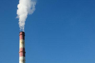 White smoke billowing from the smokestack