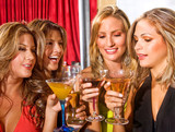 group of happy girls smiling in a bar or a nightclub poster