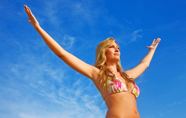 beach freedom woman with arms open having fun
