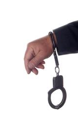 Hand wearing handcuffs