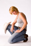 Studio portrait of a cow-girl on one knee poster