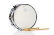Leinwanddruck Bild - A new silver snare drum with sticks on a white background