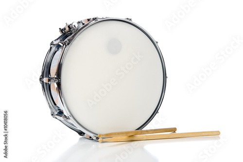 A new silver snare drum with sticks on a white background - 10418056