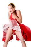 Girl in red gala dress making fun with a ventilator
