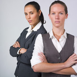 serious businesswomen with crossed arms poster