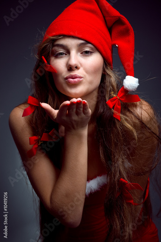Santa helper girl giving a kiss to you