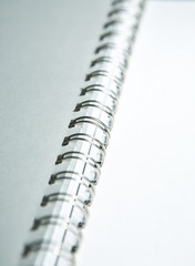 Metal binding of paper pages on a white background
