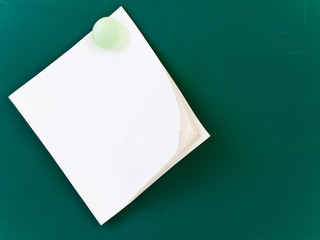 blank white memo on the green board