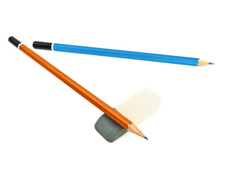 two pencils and eraser against the white background
