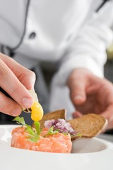 Chef prepearing salmon salad
