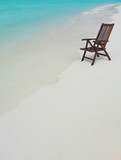 Fototapety chair on the beach with hat