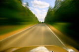 car drive motion blured on hight speed poster