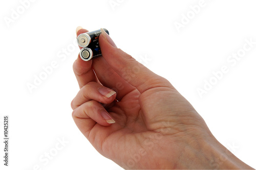 An isolated image of two AAA batteries held between fingers