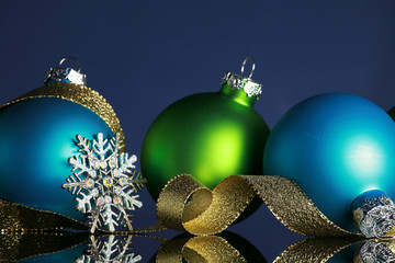 Christmas ornaments on blue background, focus ball and ribbon