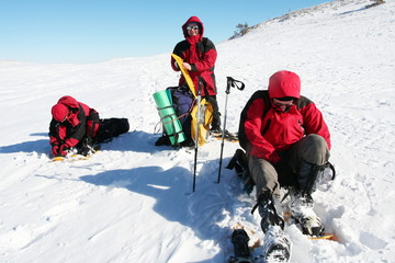 hikers in winter mountain