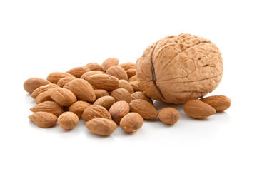 Walnut and almonds on a white background
