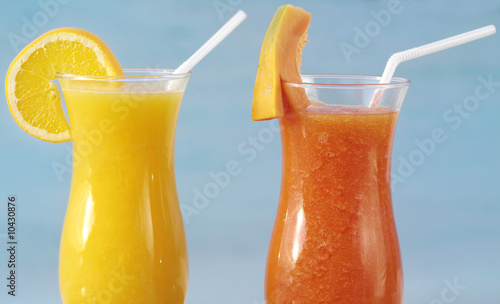 two fresh juice orange and papaya on blue sky