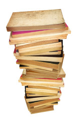 pile of old stained books against white background