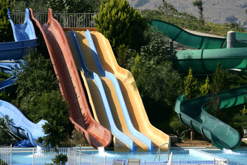 An image of colorful waterslide in summer time