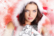 Attracive girl in santa cloth.