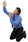 young business man on his knees looking up poster