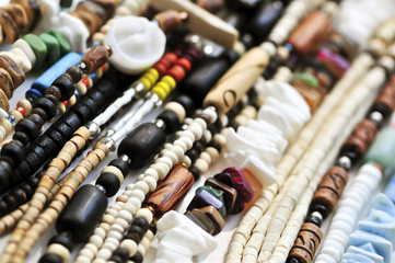 Wood and seashell bead necklaces close up
