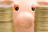 Piggy bank with two towers of coins-Shallow DOF- poster
