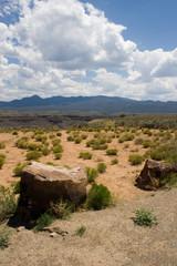 large boulders dot an otherwise desert landscape