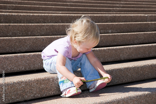 toddler plays on a massiv stone stiarcase