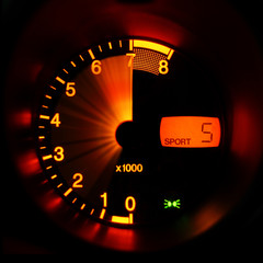 Accelerating sport-car tachometer closeup