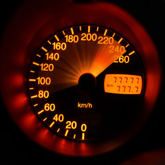 Accelerating sport-car speedometer closeup