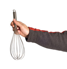 A male arm holding a kitchen whisk