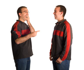 A man pointing and laughing at his identical twin