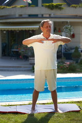 Healthy looking active senior man doing workout exercise.
