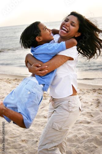 Mother & Son Having Fun at the Beach