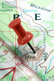 Red Push Pin on Topographical Map Indicating Mining Claim