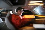 Man driving car at night, speeding fast. poster
